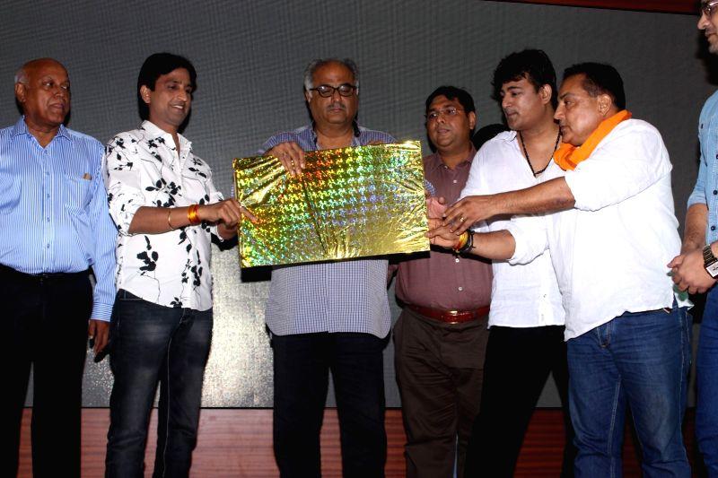 Filmmaker Boney Kapoor and Kumar Vishwas during the music launch of flim Dil Toh Deewana Hai, in Mumbai, on May 31, 2016. - Boney Kapoor