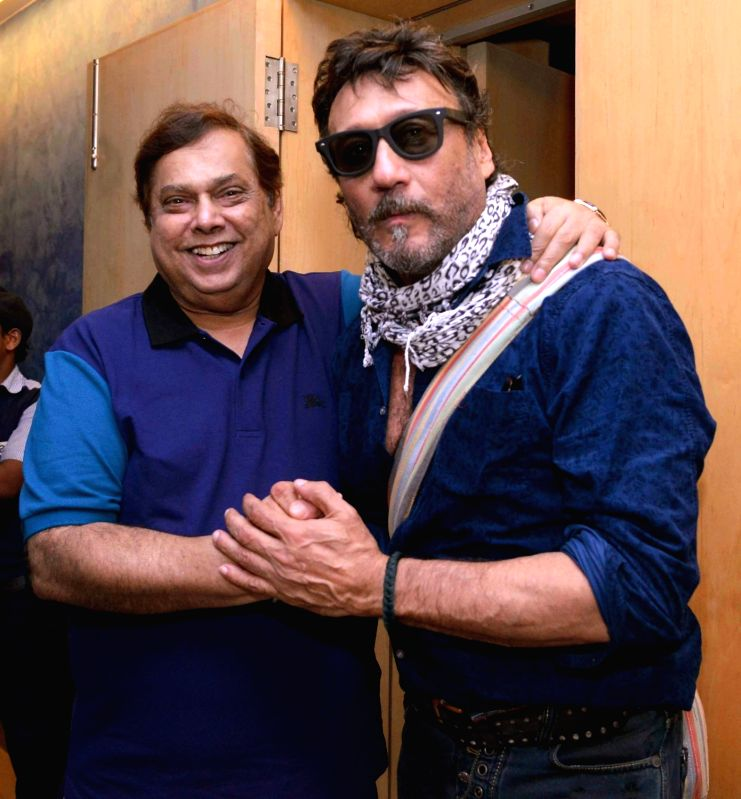 Filmmaker David Dhawan with actor Jackie Shroff during the screening of film Dishoom in Mumbai, on July 28, 2016. - David Dhawan