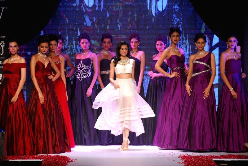Filmmaker Divya Khosla Kumar displays the creations of P N Gadgil Jewellers during the India International Jewellery Week (IIJW) in Mumbai, on July 15, 2014.