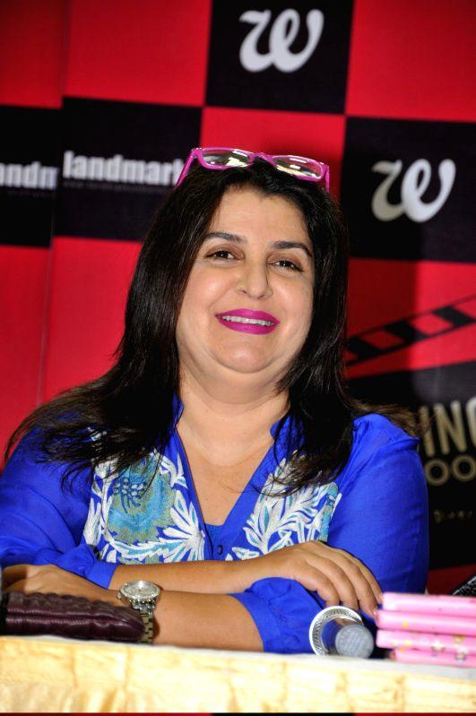 Filmmaker Farah Khan during the launch of book Decoding Bollywood by author Sonia Golani in Mumbai, on Aug 28, 2014. - Farah Khan