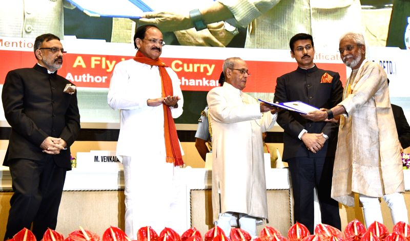 "Filmmaker K. P.Jayasankar, who won a Special Mention for ""A Fly in the Curry"", being felicitated by President Pranab Mukherjee at the 64th National Film Awards Function, in New ... - K. P., M. Venkaiah Naidu, Pranab Mukherjee and Rajyavardhan Singh Rathore"