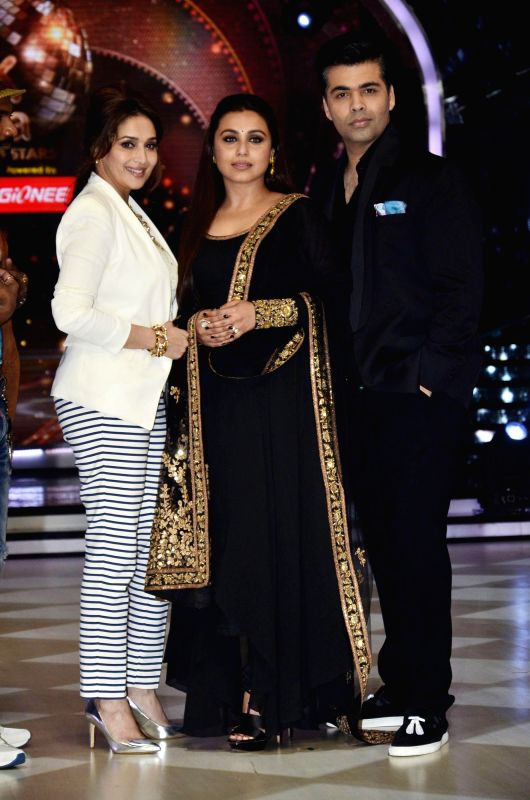Filmmaker Karan Johar, actor Madhuri dixit and Rani Mukherji on the sets of Jhalak Dikhhla Jaa 7 during the promotion of film Mardaani in Mumbai on July 22, 2014. (Photo : IANS) - Karan Johar
