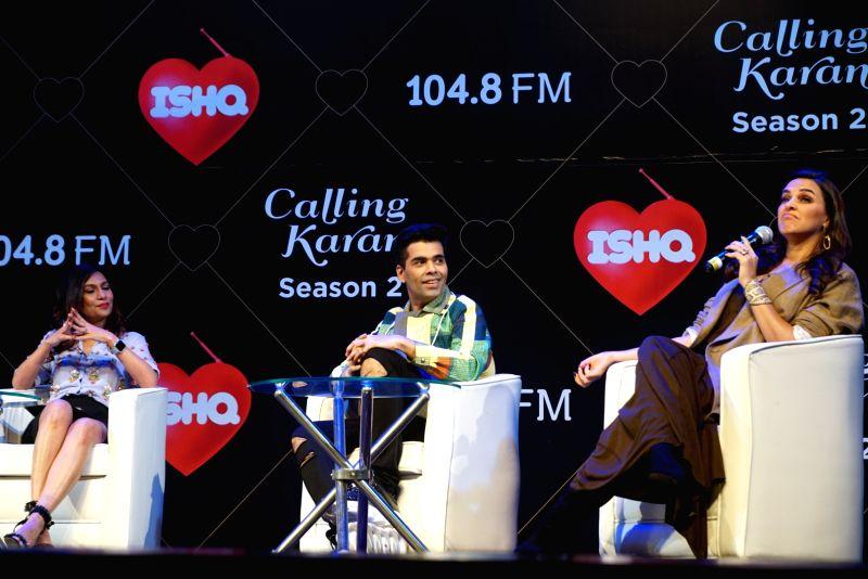 """Filmmaker Karan Johar and actress Neha Dhupia at the launch of upcoming radio show """"Calling Karan Season 2"""" in Mumbai on Aug 6, 2018. - Karan Johar and Neha Dhupia"""