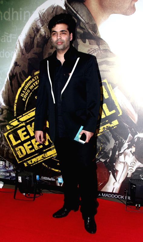 Filmmaker Karan Johar during the premiere of film Lekar Hum Deewana Dil at PVR Cinemas in Mumbai, on July 3, 2014. - Karan Johar