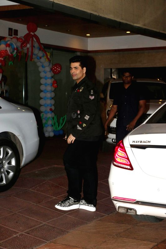 Filmmaker Karan Johar during Tussar Kapoor son Laksshay`s first birthday party in Mumbai on June 1, 2017. - Karan Johar and Tussar Kapoor