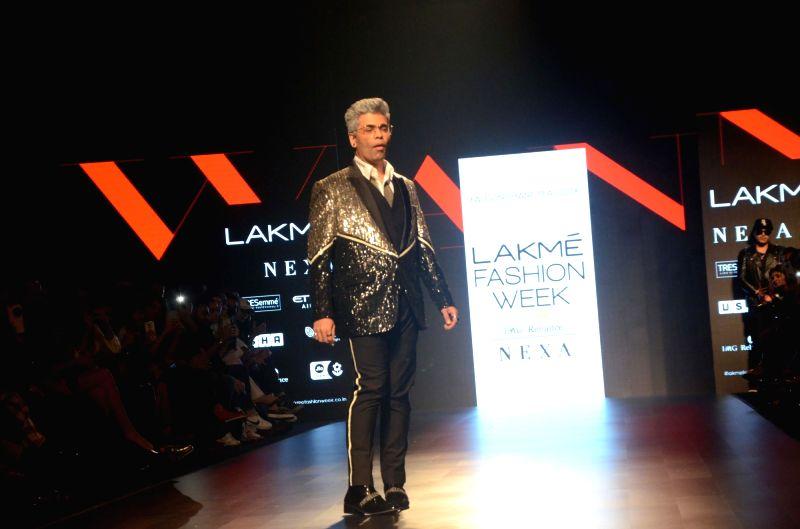 Filmmaker Karan Johar walk the ramp for fashion designer Falguni and Shane Peacock during the Lakme Fashion Week Summer/Resort 2018 in Mumbai on Feb 2, 2018. - Karan Johar
