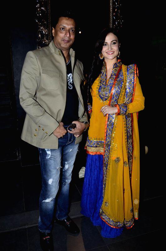 Filmmaker Madhur Bhandarkar and actor Elli Avram during the launch of store Grand Trunk Show in Mumbai, on April 18, 2014. - Madhur Bhandarkar