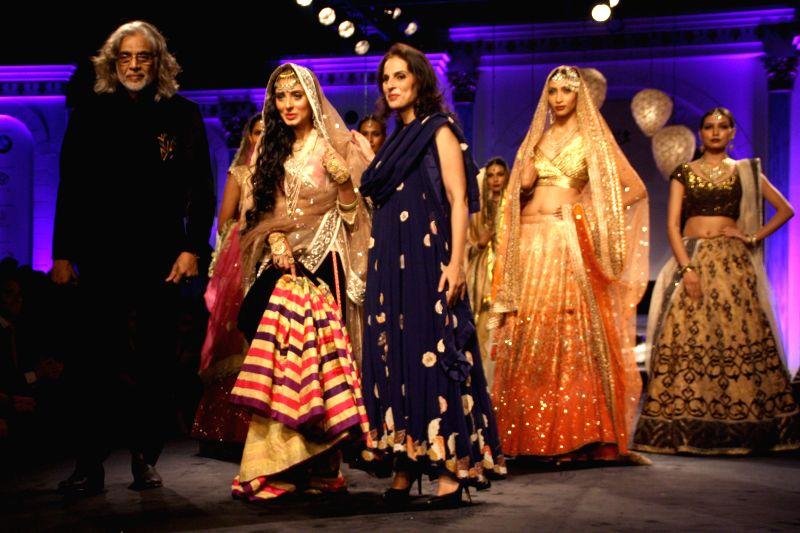 Filmmaker Muzaffar Ali with his wife and fashion designer Meera Muzaffar Ali during `BMW India Bridal Fashion Week 2014` in New Delhi on Aug 10, 2014.