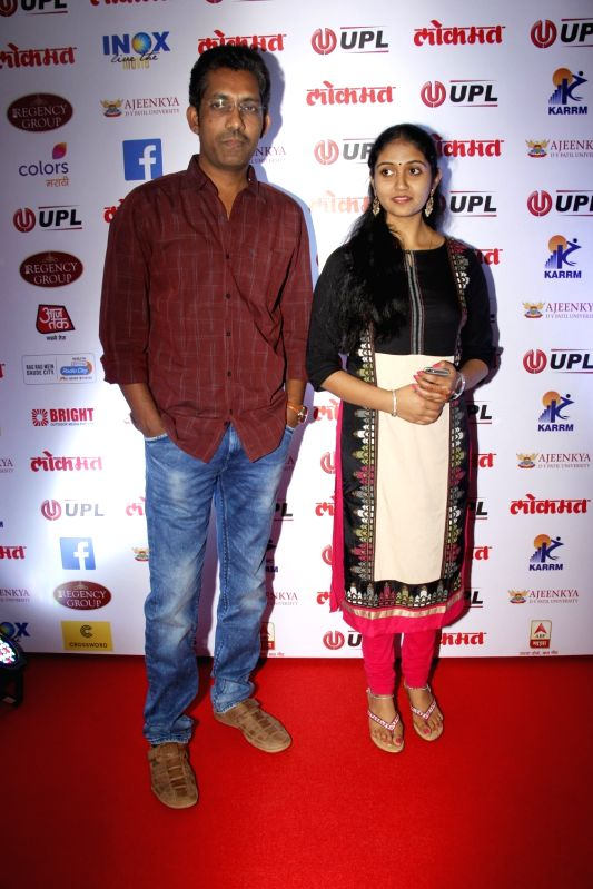 Filmmaker Nagraj Manjule and actor Rinku Rajguru arrives to attend the 4th edition Lokmat Maharashtrian of The Year 2017 in Mumbai on April 11, 2017. - Nagraj Manjule