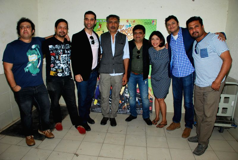Filmmaker Prakash Jha with the stars-cast of his upcoming film `Crazy Cukkad Family` at the audio launch of the film in Mumbai on Dec 23, 2014. - Prakash Jha