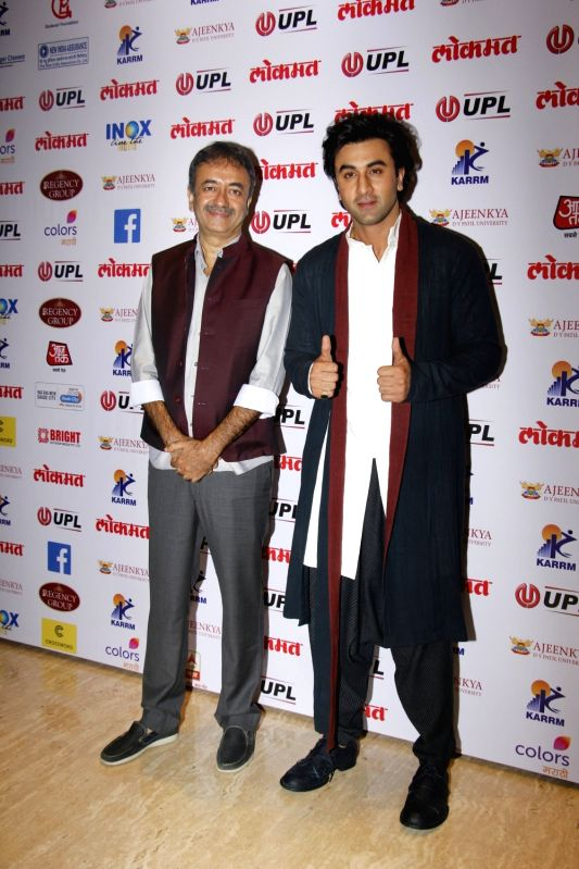 Filmmaker Rajkumar Hirani and actor Ranbir Kapoor arrives to attend the 4th edition Lokmat Maharashtrian of The Year 2017 in Mumbai on April 11, 2017. - Rajkumar Hirani and Ranbir Kapoor