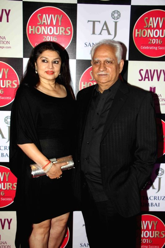 Filmmaker Ramesh Shippy with his wife Kiran Sippy during the SAVVY Honours Award for Women Entrepreneur in Mumbai on July 24, 2016. - Ramesh Shippy