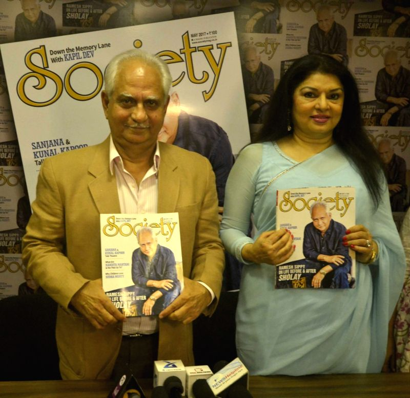 Filmmaker Ramesh Sippy along with his wife and actor Kiran Juneja during the unveiling of the May 2017 issue of Society magazine in Mumbai, on May 16, 2017. - Ramesh Sippy