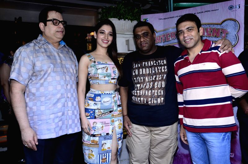 Filmmaker Ramesh Taurani, actor Tamannaah Bhatia and filmmakers Sajid and Farhad during the promotion of film Entertainment and support of a charity exhibition in Mumbai, on August 2, 2014. - Ramesh Taurani