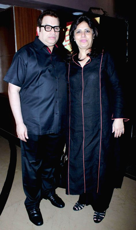 Filmmaker Ramesh Taurani with wife during the special screening of film Humpty Sharma ki Dulhania in Mumbai on July 10, 2014. - Ramesh Taurani