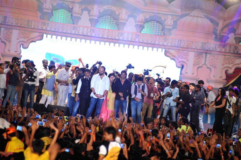 Filmmaker Rohit Shetty and actor Ajay Devgn during Shri Sankalp Pratishthan`s Dahi Handi celebrations in Mumbai on Aug. 18, 2014. - Rohit Shetty and Ajay Devgn
