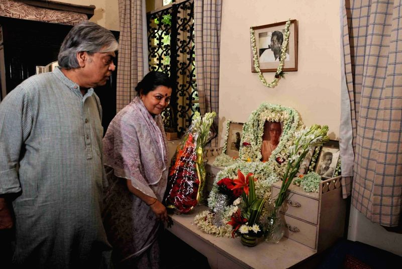 Filmmaker Sandip Ray along with his wife pays tribute to his father and renowned filmmaker Satyajit Ray on his birth anniversary at his residence in Kolkata on May 2, 2017. Satyajit Ray was ... - Sandip Ray