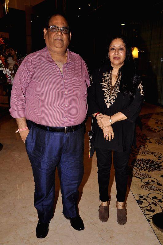 Filmmaker Satish Kaushik with his wife Shashi during the Medha Jalota's birthday party in Mumbai on June 25, 2014. - Satish Kaushik