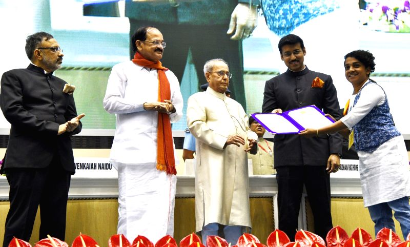 "Filmmaker Soumya Sadanandan, who won a Special Mention for ""CHEMBAI - Descoperire A Mea Unei Legende"" (CHEMBAI - My Discovery of a Legend), being felicitated by President Pranab ... - Soumya Sadanandan, M. Venkaiah Naidu, Pranab Mukherjee and Rajyavardhan Singh Rathore"