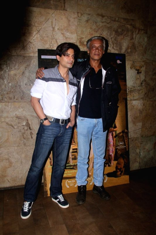Filmmaker Sudhir Mishra and actor Rahul Bhat during the special screening of Punjabi film Chauthi Koot in Mumbai on Aug 1, 2016. - Sudhir Mishra