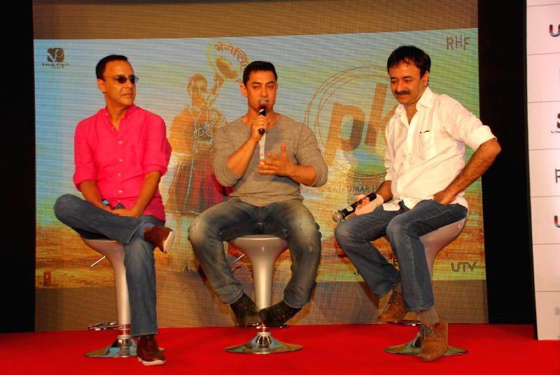Filmmaker Vidhu Vinod Chopra, actor Aamir Khan and filmmaker Rajkumar Hirani during the launch of second poster of film PK in Mumbai, on Aug. 20, 2014. - Vidhu Vinod Chopra and Aamir Khan