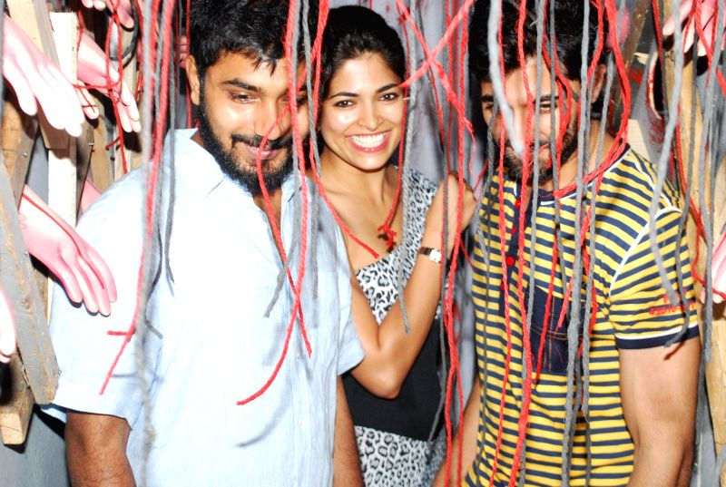 Filmmakers Akshay Akkinen and actors Parvathy Omanakuttan and Akshay Oberoi during the promotion of film Pizza in Mumbai on July 11, 2014. - Akshay Akkinen, Parvathy Omanakuttan and Akshay Oberoi