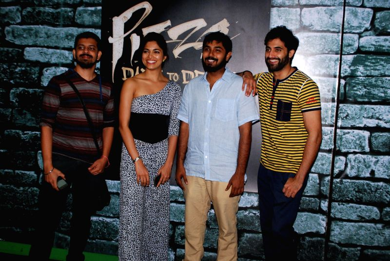 Filmmakers Akshay Akkineni, Bejoy Nambiar and actors Parvathy Omanakuttan and Akshay Oberoi during the promotion of film Pizza in Mumbai on July 11, 2014. - Akshay Akkineni, Bejoy Nambiar, Parvathy Omanakuttan and Akshay Oberoi
