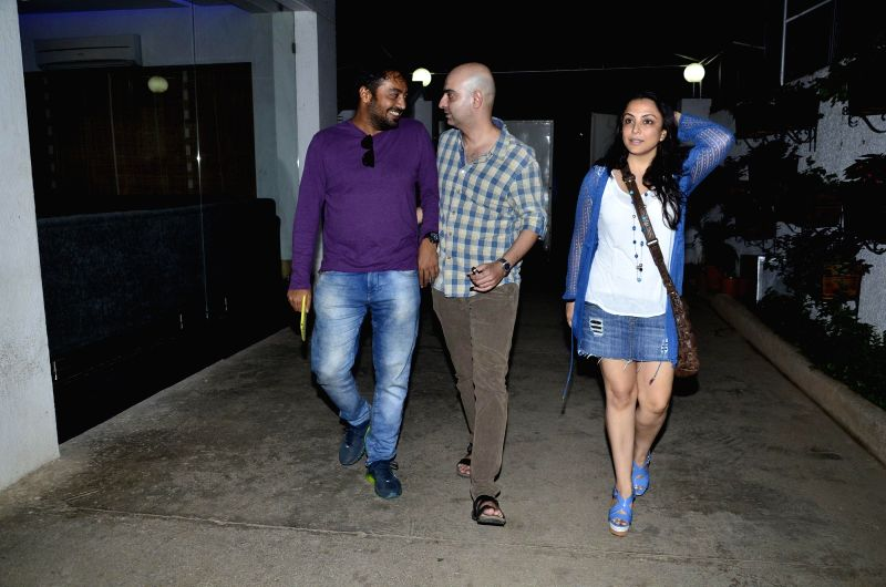 Filmmakers Anurag Kashyap , Abbas Tyrewala with wife Pakhi during the first look of documentary film The World Before Her at juhu in Mumbai on 22nd April 2014. - Anurag Kashyap