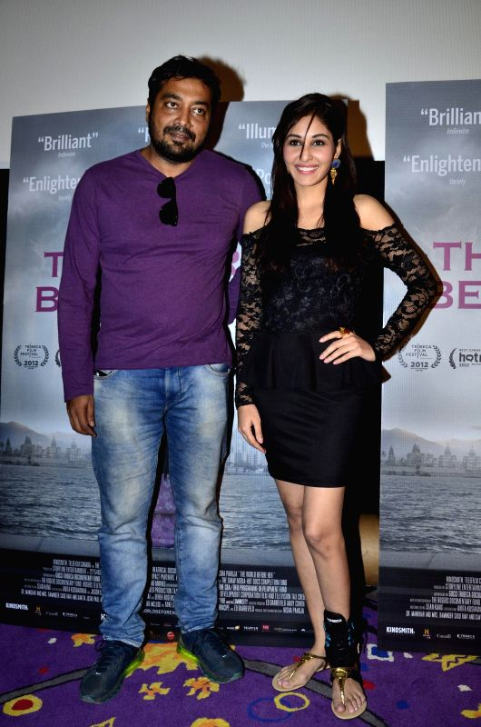 Filmmakers Anurag Kashyap and Miss India Pooja Chopra during the first look of documentary film The World Before Her at juhu in Mumbai on 22nd April 2014. - Anurag Kashyap and Miss India Pooja Chopra