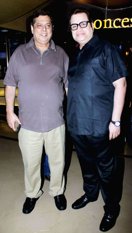 Filmmakers David Dhawan and Ramesh Taurani during the special screening of film Humpty Sharma ki Dulhania in Mumbai on July 10, 2014. - David Dhawan and Ramesh Taurani