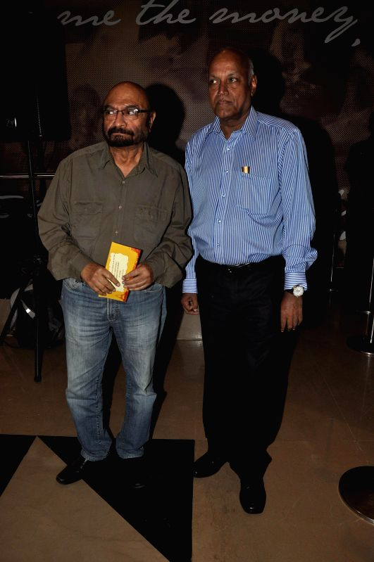 Filmmakers Govind Nihalani and Manmohan Shetty during the screening of Hollywood film The Hundred-Foot Journey in Mumbai on August 7, 2014. - Govind Nihalani and Manmohan Shetty