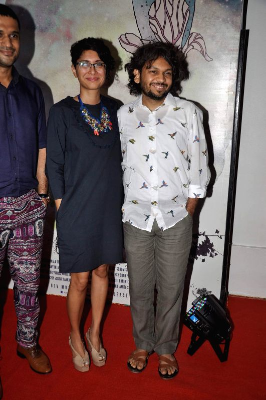 Filmmakers Kiran Rao and Anand Gandhi during the success party of the films Shahid and Ship of Theseus in Mumbai on May 13, 2014. - Kiran Rao and Anand Gandhi