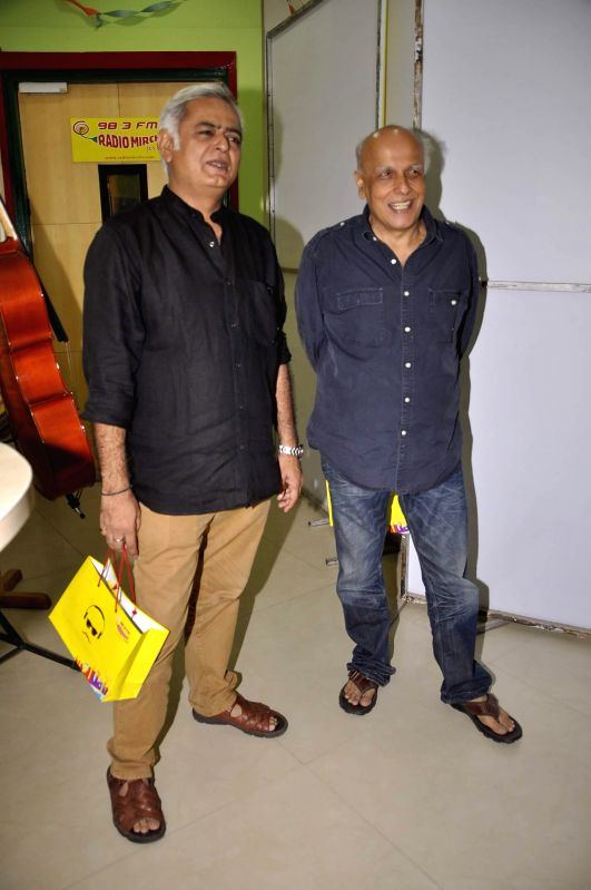 Filmmakers Mahesh Bhatt and Hansal Mehta during the meet and greet session on Radio Mirchi to promote their upcoming film City Lights in Mumbai, on May 14, 2014. - Mahesh Bhatt and Hansal Mehta