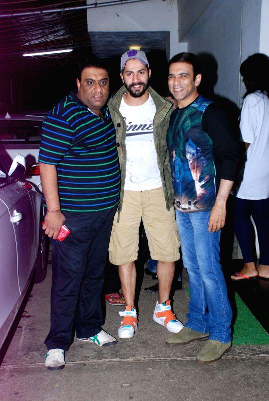 Filmmakers Sajid Samji and Farhad Samji with actor Varun Dhawan during the screening of the film Entertainment in Mumbai on Aug 6, 2014. - Varun Dhawan, Sajid Samji and Farhad Samji