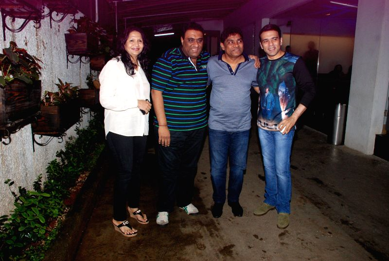 Filmmakers Sajid Samji and Farhad Samji with Bollywood actor Johnny Lever with his wife Sujatha Lever during the screening of the film Entertainment in Mumbai on Aug 6, 2014. - Johnny Lever, Sajid Samji and Farhad Samji