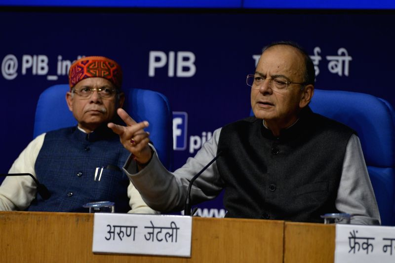 Finance Minister Arun Jaitley with Union MoS Finance Shiv Pratap Shukla addresses a press conference after the presentation of Union Budget 2018-19, in New Delhi on Feb 1, 2018. - Arun Jaitley