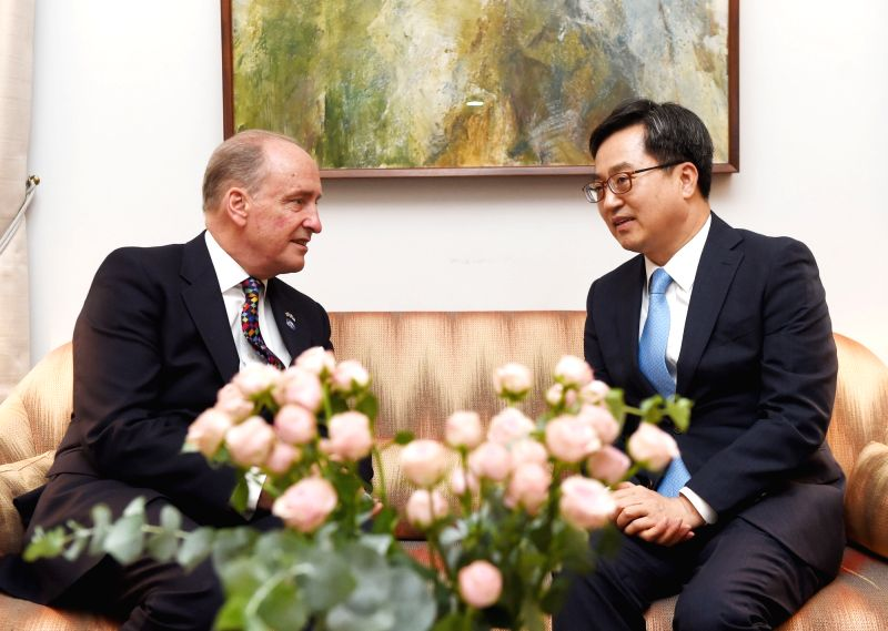 Finance Minister Kim Dong-yeon (R) meets Charles Bowman, lord mayor of London, at the British embassy in Seoul on July 13, 2018, in this photo from South Korea's finance ministry. Not to be ... - Kim Dong