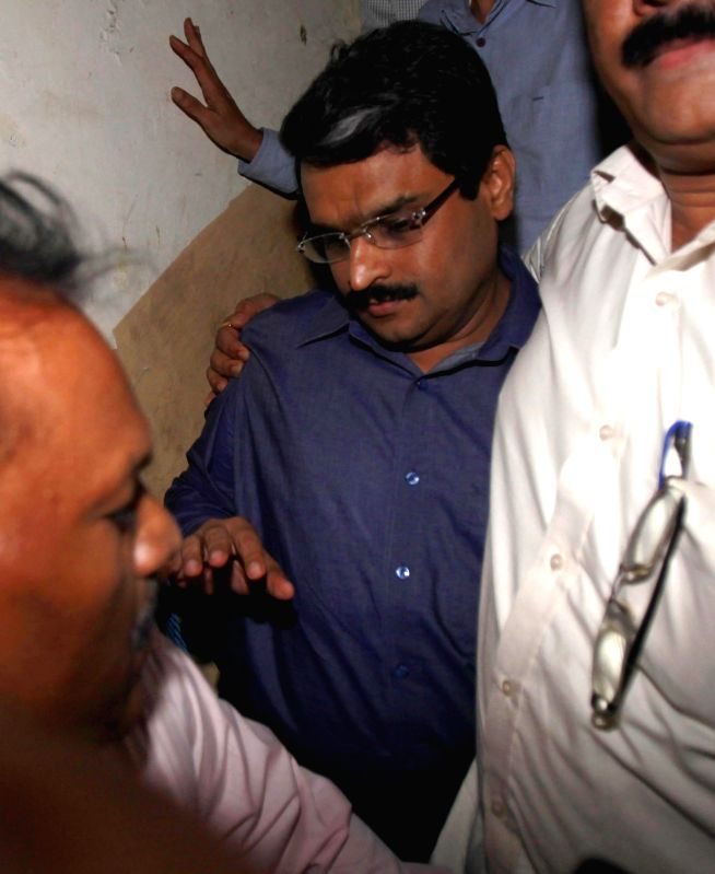 Financial Technolgies (India) Ltd chairman Jignesh Shah who was arrested in connection with the Rs.5,574.34 crore NSEL payments crisis of last year being taken to be produce in a Mumbai court on May .