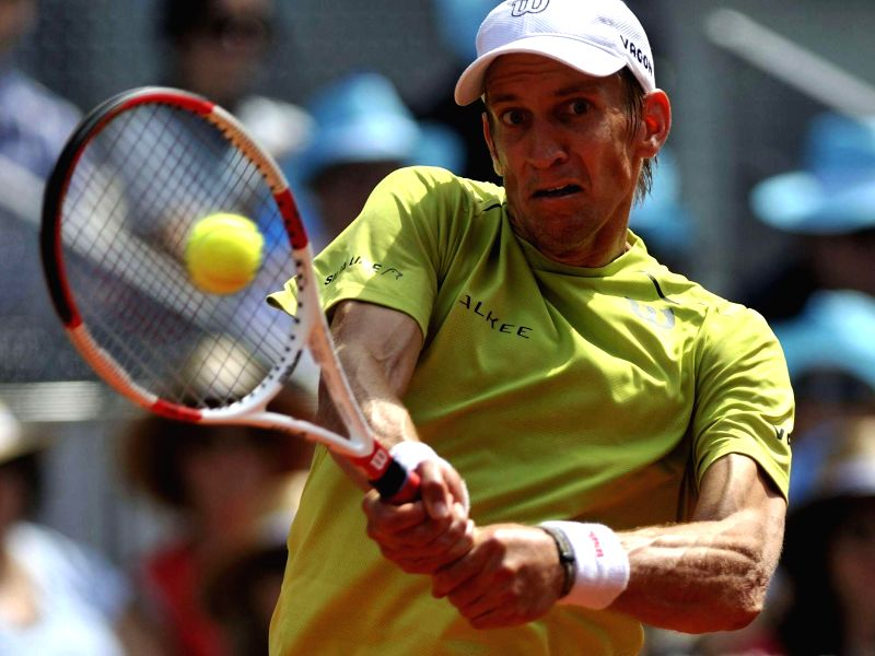 Finnish tennis player Jarkko Nieminen in action against his Spanish counterpart Rafael Nadal during the third round match of the Madrid ATP Tennis Open Singles in Madrid, Spain on May 8, 2014. Nadal .
