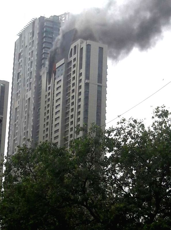 Fire breaks out at Beaumonte Towers in Prabhadevi of Mumbai on June 13, 2018. At least 90 residents were evacuated safely. According to officials, the fire was seen around 2.10 pm on the ...