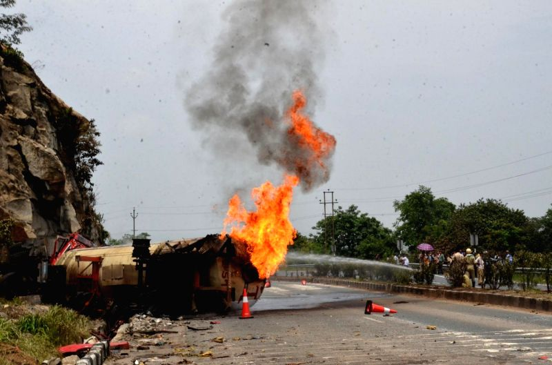 Fire breaks out in a tanker that was involved in a collision between a bus and a truck carrying LPG cylinders on National Highway 33 near Chutupalu valley in Ramgarh district of Jharkhand on ...