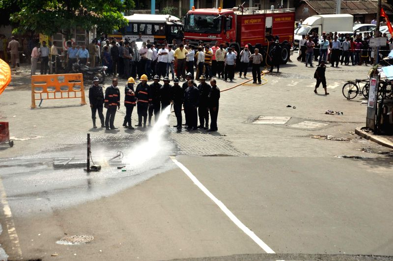 Fire brigade arrives at the spot where an underground gas leakage was detected at Worli Naka in Mumbai on July 17, 2014.