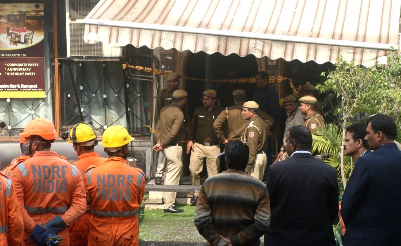 Fire fighters and NDRF personnel outside Hotel Arpit Palace in Karol Bagh where a major fire broke out killing seventeen people, including a child and injuring three others in New Delhi on ...