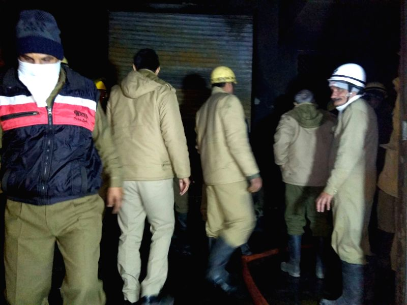 Fire fighters at the plastic warehouse where a fire broke out killing at least nine persons in west Delhi's Bawana area on Jan 20, 2018.