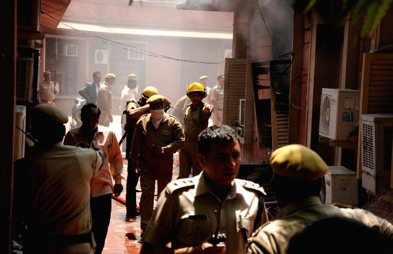 Fire fighters douse a fire that broke out in the Supreme Court premises in New Delhi on April 27, 2014.