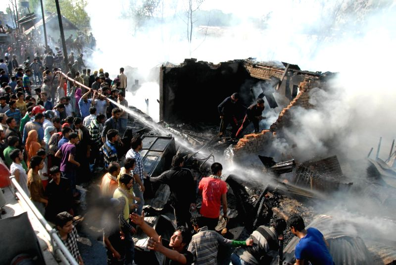 Fire fighters douse try hard to douse a fire which broke-out at Chattabal Area of Srinagar in which reportedly 15 residential houses and five business establishments were destroyed, on April 29, ...