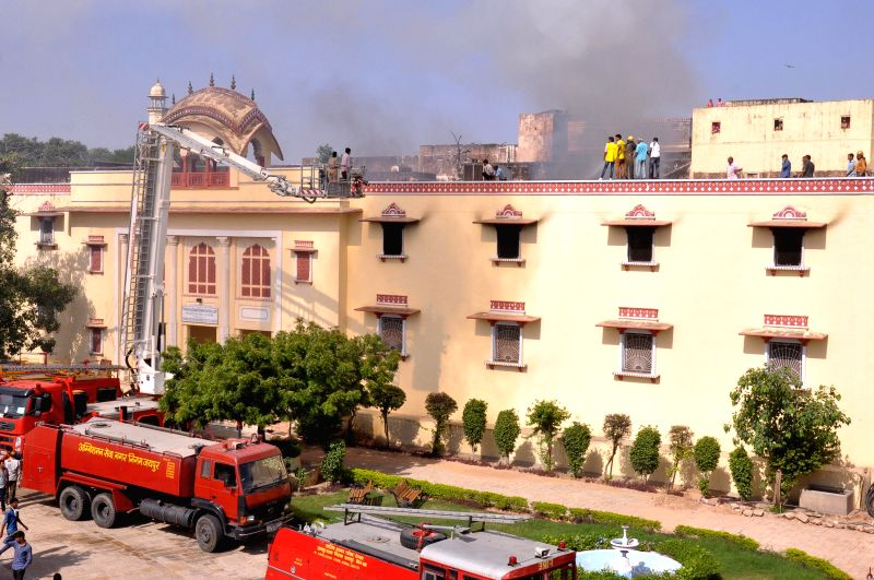 Fire fighters try hard to douse a fire that broke out at City Palace, Sawai Bhawani Singh Gallery Museum in Jaipur on Aug 24, 2014.