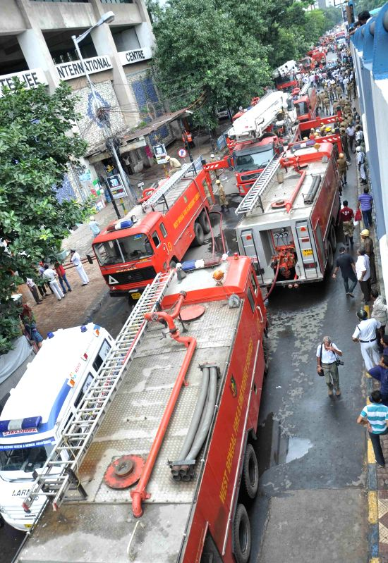Fire tenders parked outside Kolkata`s landmark Chatterjee International building where a fire broke out on Sept 2, 2014.
