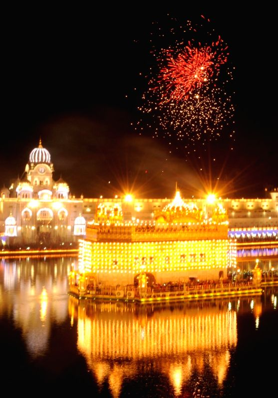 Fire works light up the sky above the Golden Temple on Guru Nanak Jayanti, in Amritsar