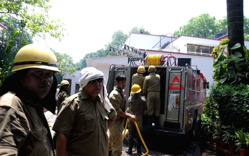 Firefighters arrive to douse a fire that broke out at NCP general secretary Tariq Anwar's storeroom in New Delhi, on May 30, 2016.